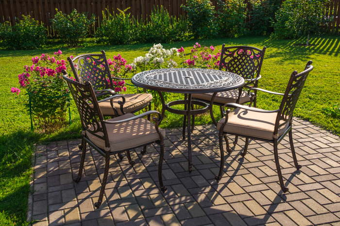 Matching garden furniture for small gardens will help maximise space