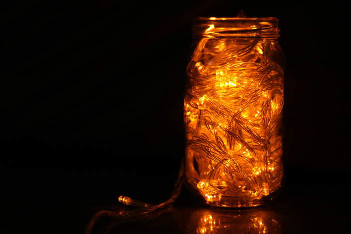 fairy lights placed in old jars
