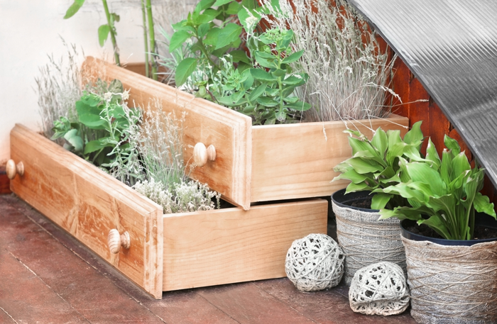 old drawers being reused as plant beds