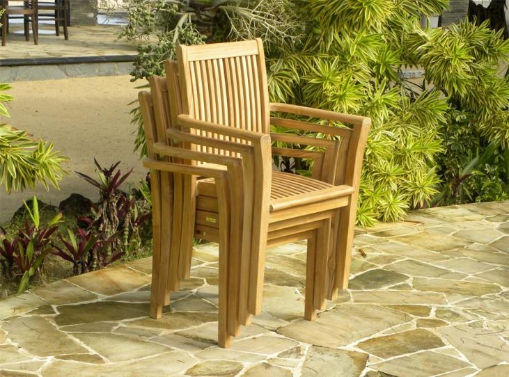 Grenada Chairs shown stacked in a group of 4. Up to 6 can be stacked.