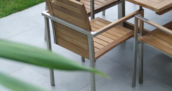 close up of Rivira teak and stainless steel patio chair