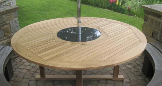 ...it fits nicely...definitely the nicest round table I have seen and I have been looking for over two years!